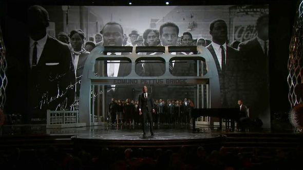 Image: Still from performance of John Legend and Common performing